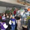 Tri Star students work to unload the canned goods they donated to Agape Food Pantry, St. Marys: Gallery Image 8