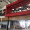 "Wood trim has been added to the foyer/commons area.  The upper floor features a red  ""sky box"".: Gallery Image 2"