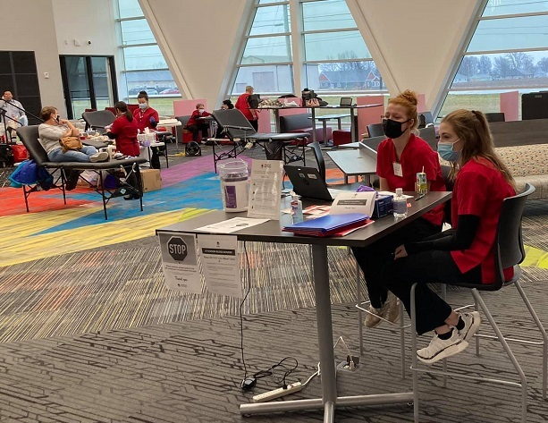 Student volunteers wait for the next donors at the Dec. 30th blood drive.: Featured Image 1